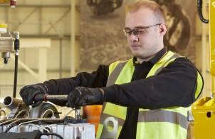 Fitter working on new JCB Dieselmax 672