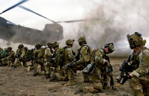 US Army Rangers crouch as a Chinook helicopter takes off - photo by Spc. Steven Hitchcock