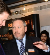 Nick Clegg MP, UK Deputy Prime Minister, left, with Renishaw's Rhydian Pountney and Sanjay Sangam