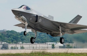Australia's first F-35 named AU 1 takes off for its first flight - image courtesy of Lockheed Martin with photos by Liz Kaszynski and Alexander Groves