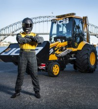 The world's fastest digger takes a lap of honour around Sydney.