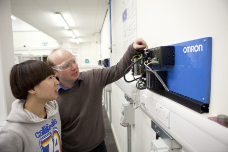 Alan Thorne, Technical Officer for the Automation Laboratory and MET course lecturer, demonstrates an Omron PLC to a student